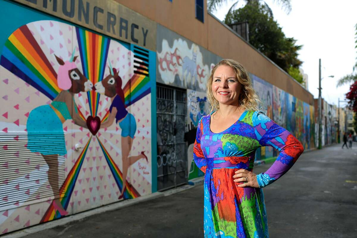 Crystal Vielula stands for a portrait next to a mural she created in Clarion Alley on Thursday, August 30, 2018 in San Francisco, Calif.