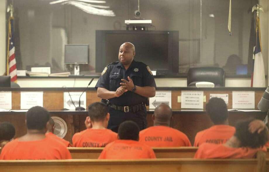 Harris County Sheriff's Deputy D. Walker speaks to defendants before a probable cause hearing Tuesday, Dec. 19, 2017, in Houston. ( Jon Shapley / Houston Chronicle ) Photo: Jon Shapley, Staff Photographer / Houston Chronicle / © 2017 Houston Chronicle