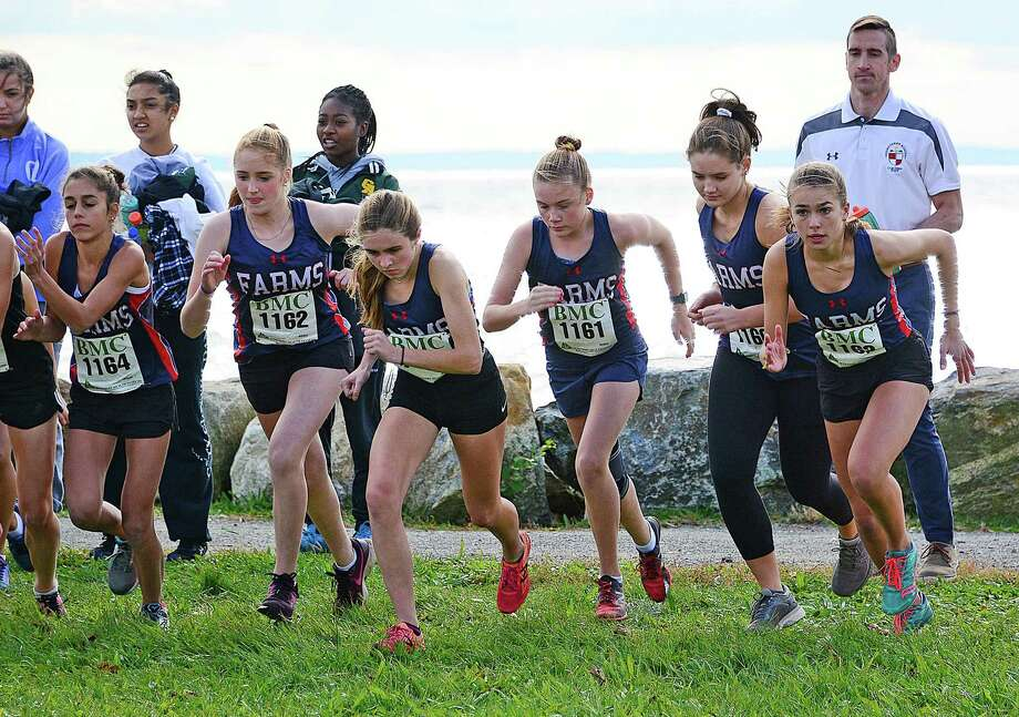 The Greens Farms Academy girls cross country team heads out from the starting line at Monday's FAA championship meet at Sherwood Island State Park in Westport. Led by Caroline McCall, far right, who placed third overall, the Dragons placed third as a team. Photo: Greens Farms Academy Athletics / Contributed Photo