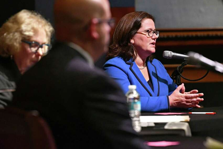 Republican incumbent Joel Abelove, center, and Democratic candidate Mary Pat Donnelly, right, participate in a forum for Rensselaer County District Attorney moderated by Mary Berry, Esq., left, from the League of Women Voters of Albany County at the Rensselaer Polytechnic Institute Chapel on Monday, Oct. 29, 2018 in Troy, N.Y. (Lori Van Buren/Times Union)
