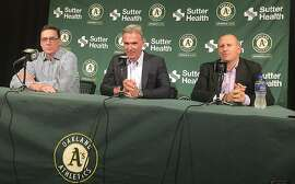 From left, Oakland Athletics manager Bob Melvin, executive vice president of baseball operations Billy Beane and general manager David Forst take part in a news conference about their long-term contract extensions in Oakland, Calif., Monday, Oct. 29, 2018. The club announced the extensions Monday. Under Melvin's guidance, a young, slugging Oakland club went 97-65 and lost the wild-card game 7-2 to the New York Yankees. (AP Photo/Janie McCauley)