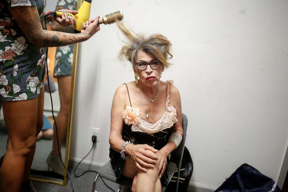 Jaylyn Abergas does Donna Personna's hair as they prepare for a reading of Personna's play about the Compton Cafeteria Riot in San Francisco in 1966, a during a fundraiser in support of Prop E at Safehouse Arts on Friday, October 26, 2018 in San Francisco, Calif. Photo: Amy Osborne / Special To The Chronicle