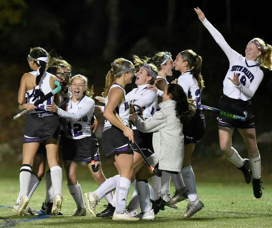 Clinton, Connecticut - Monday, October 29, 2018: The North Branford H.S. field hockey team surround teammate Ali Barrett,  celebrating their triple overtime 2-1 victory over Valley Regional in the Shoreline Conference field hockey semifinals Monday at Indian River Complex in Clinton. Photo: Peter Hvizdak, Hearst Connecticut Media / New Haven Register