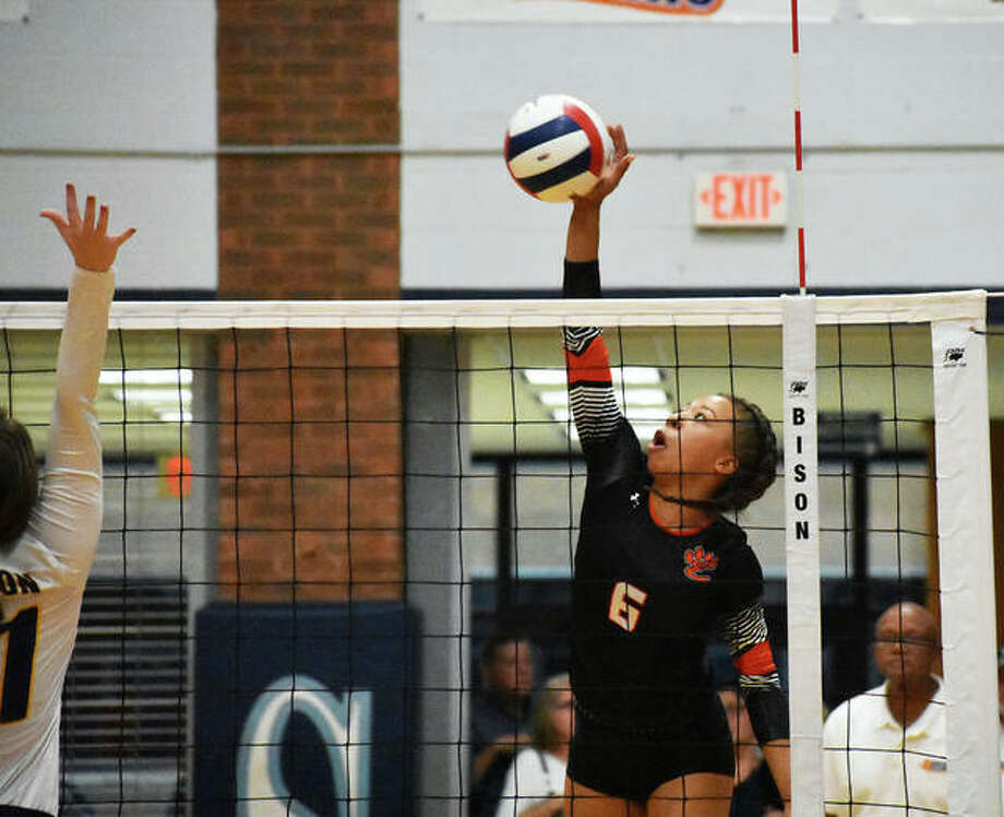 Edwardsville sophomore Alexa Harris slams down a kill against O'Fallon during the first game of the Class 4A Bloomington Sectional semifinals on Monday at Belleville East. Photo: Matt Kamp/Intelligencer