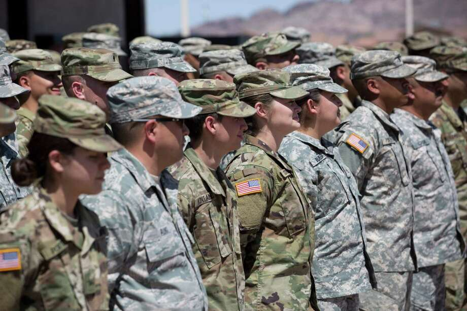 "(FILES) In this file photo taken on April 09, 2018, members of the Arizona National Guard listen to instructions at the Papago Park Military Reservation in Phoenix. - The Pentagon is expected to deploy about 800 troops to the US-Mexico border, two US officials told AFP on Thursday, October 25, 2018, after President Donald Trump said the military would help tackle a ""national emergency"" and called on a caravan of migrants to ""turnaround."" The active-duty troops would augment the 2,000 or so National Guardsmen already deployed to support operations on the border, and could come from multiple military bases around the US. move comes as thousands of Central American migrants are crossing Mexico toward the United States in a slow-moving caravan. The issue has become a rallying cry for the US president, who has taken a hard line on illegal immigration and has repeatedly kept the story in the headlines in the run up to America's mid-term Congressional elections that could see the Democrats regain some degree of power. (Photo by Caitlin O'Hara / AFP)CAITLIN O'HARA/AFP/Getty Images Photo: CAITLIN O'HARA /AFP /Getty Images / AFP or licensors"