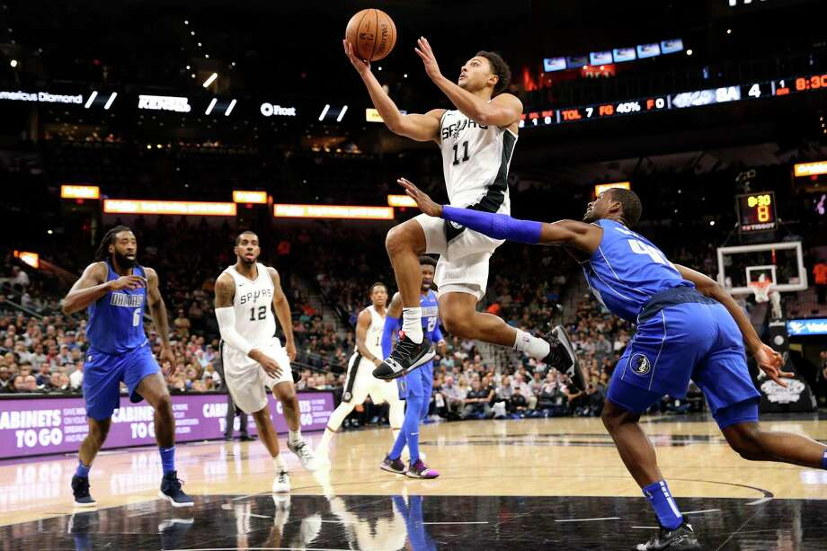 San Antonio Spurs' Bryn Forbes goes for two as Dallas Mavericks' Harrison Barnes defends during the first half at the AT&T Center, Monday, Oct. 29, 2018. Photo: JERRY LARA, San Antonio Express-News / © 2018 San Antonio Express-News