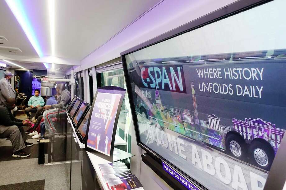 "Troy Middle School students take a tour of the C-SPAN Bus, parked outside their school on Monday, Oct. 29, 2018, in Troy, N.Y. The bus is in the Capital Region Monday and Tuesday as part of the C-SPAN's ""50 Capitals Tour"". The bus will be at the Empire State Plaza outside the capitol building in downtown Albany on Tuesday morning until 12:30pm.   (Paul Buckowski/Times Union) Photo: Paul Buckowski / (Paul Buckowski/Times Union)"
