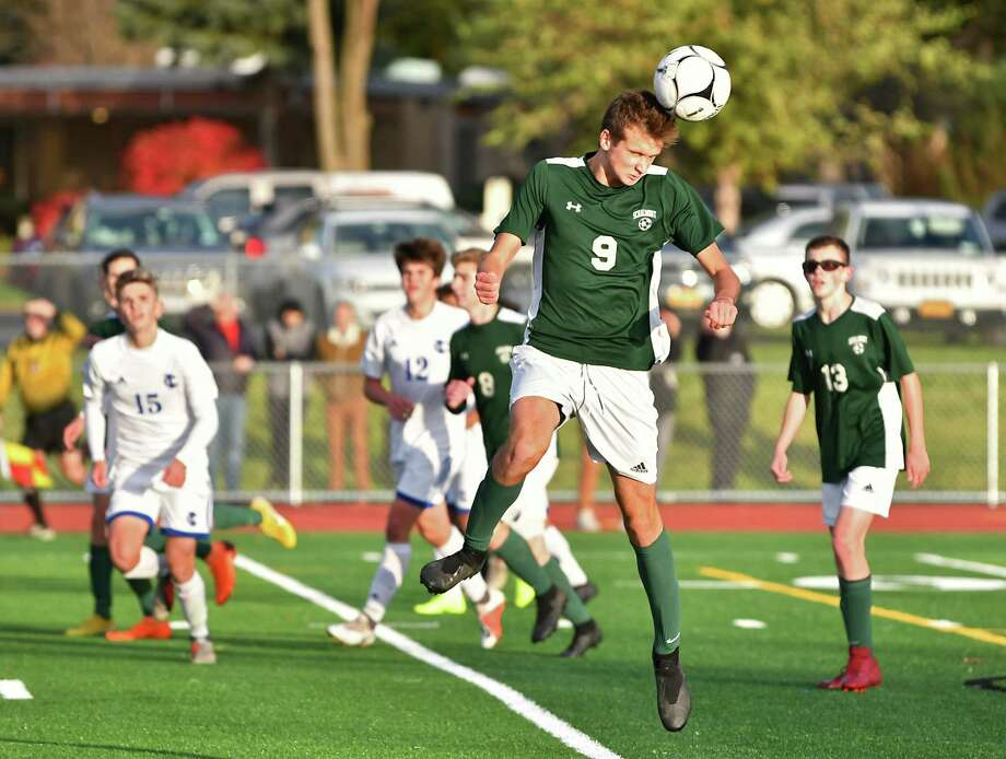 Schalmont's Gabe Comenzo, #9, heads the ball against Ichabod Crane in the Class B boys' soccer final on Monday, Oct. 29, 2018 in Troy, N.Y. (Lori Van Buren/Times Union) Photo: Lori Van Buren / 40045307A