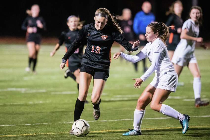 Bethelhem's Piper Gregory kicks the ball past Shenendehowa's Haylee Evertsen during the Class AA girls soccer finals against Shenendehowa at Stillwater High School Monday, October 29th, 2018 in Stillwater, NY. Photo by Eric Jenks, for the Times Union
