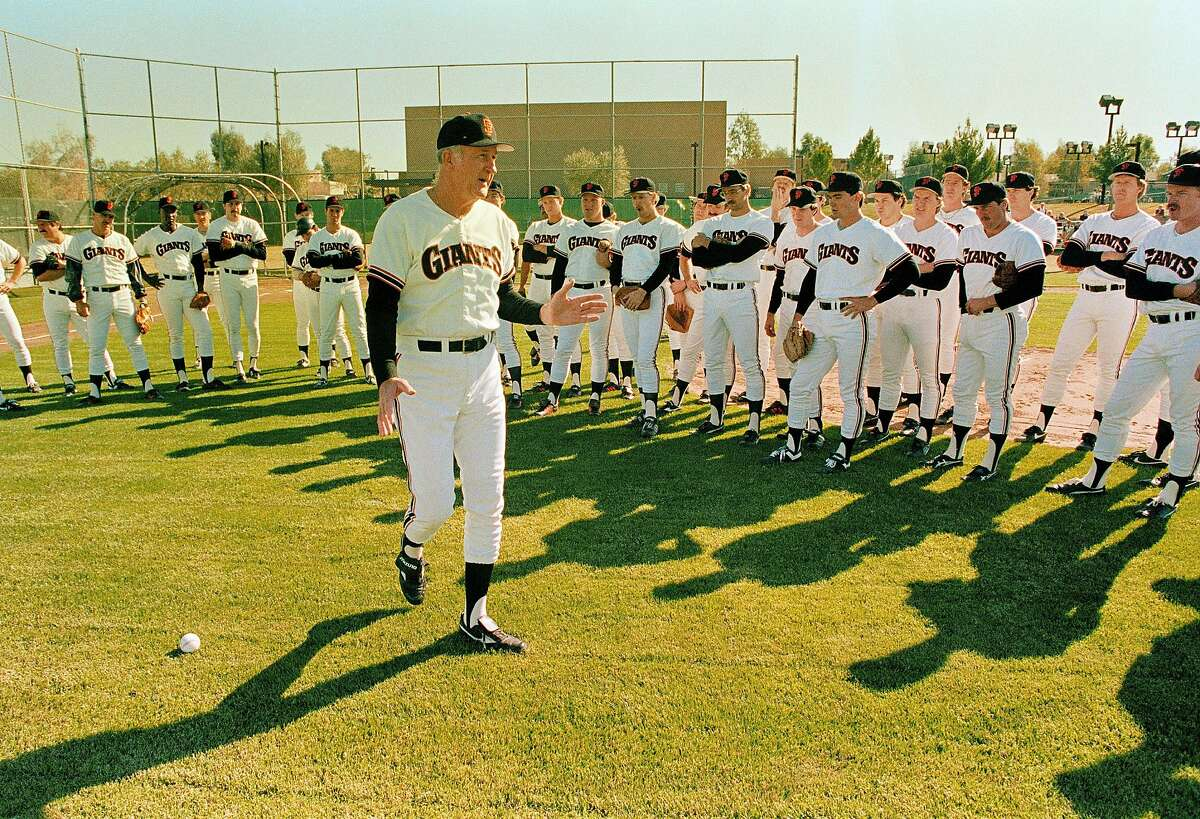San Francisco Giants head coach Roger Craig delivers a pep talk to pitchers and infielders during the opening day of spring training Friday, Feb. 21, 1986. San Francisco Giants becomes the first team to open training officially in Arizona. (AP Photo/Jeff Robbins)