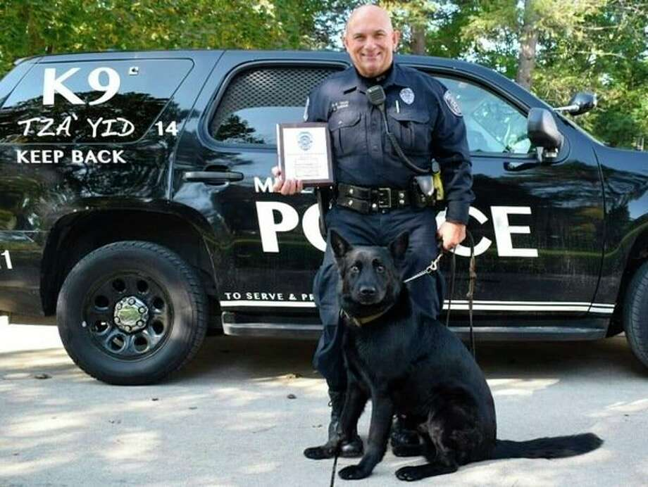 Midland Police Officer John DuBois along with Tza'Yid, an 8-year-old German shepherd. The pair have teamed up for more six years to aid local law enforcement. (Photo provided)