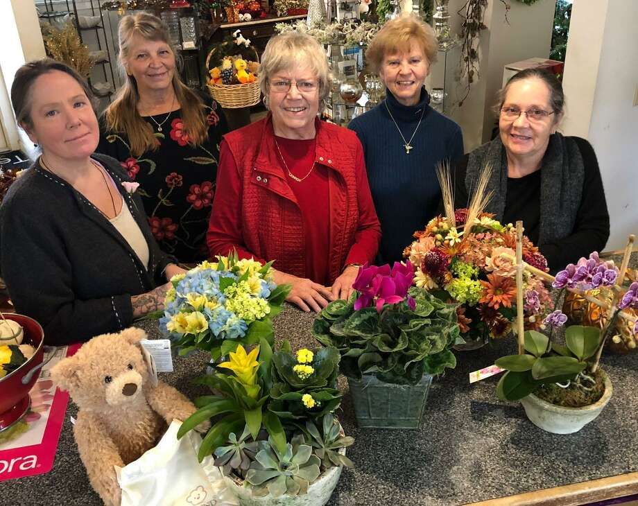 Lennie's Flower Shop is celebrating its 35th anniversary. Owner Lennie Lillis, front center, is shown with some of her staff, from left to right, in front, designer and manager Suzanne Koerner, and designer and plant expert Leslie Seybold, and in back, designer and flower prep professional Gail Scribner and designer Annette Golembeski. Photo: Deborah Rose / Hearst Connecticut Media / The News-Times  / Spectrum