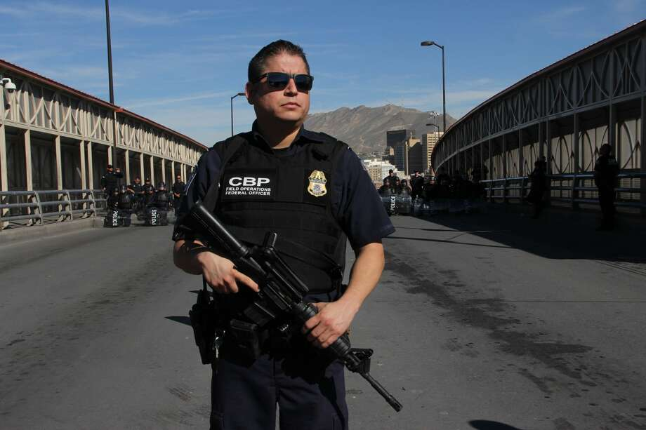 US customs and border patrol agents and riot policemen take part in a border security drill at the US-Mexico international bridge, as seen from Ciudad Juarez, Mexico, on October 29, 2018. - Dozens of migrants get to the border crossing linking El Paso, Texas and Ciudad Juarez, Chihuahua state, every day, ahead of a caravan of Central Americans seeking political asylum in the United States. (Photo by Herika Martinez / AFP)        (Photo credit should read HERIKA MARTINEZ/AFP/Getty Images) Photo: HERIKA MARTINEZ/AFP/Getty Images, Getty