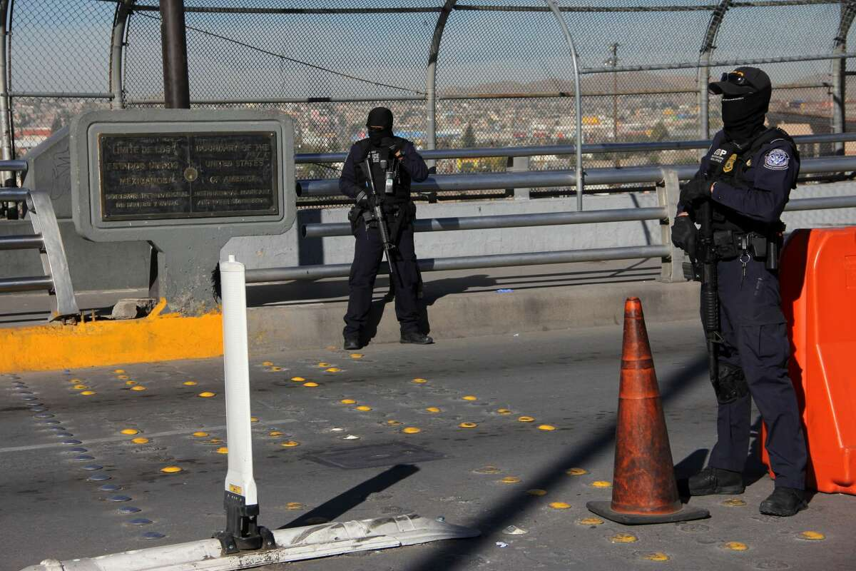 US customs and border patrol agents stand guard at the US-Mexico international bridge, as seen from Ciudad Juarez, Mexico, on October 29, 2018. - Dozens of migrants get to the border crossing linking El Paso, Texas and Ciudad Juarez, Chihuahua state, every day, ahead of a caravan of Central Americans seeking political asylum in the United States. (Photo by Herika Martinez / AFP) (Photo credit should read HERIKA MARTINEZ/AFP/Getty Images)