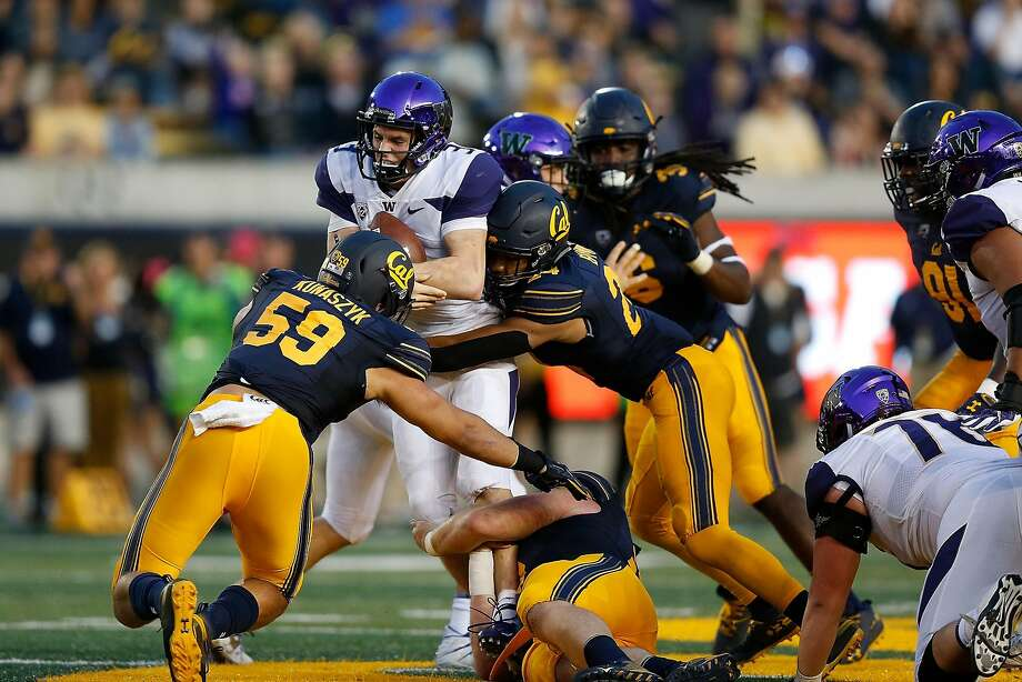 Quarterback Jake Browning #3 of the Washington Huskies is tackled by Camryn Bynum #24 of the California Golden Bears at California Memorial Stadium on October 27, 2018 in Berkeley, Calif. Photo: Lachlan Cunningham, Getty Images
