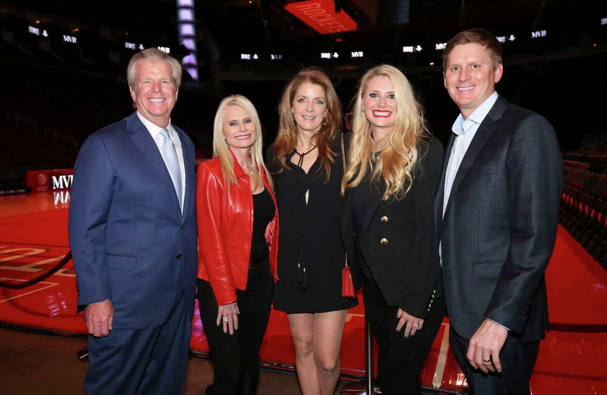Paige Fertitta, center, Jo Lynn and Gregg Falgout, left, and Christine Falgout-Gutknecht and Bill Gutknecht pose for a photograph at the Lexus Lounge before the MVPs courtside dinner, hosted by Houston Rockets and Children's Memorial Hermann, at Toyota Center on Thursday, Oct. 25, 2018, in Houston.