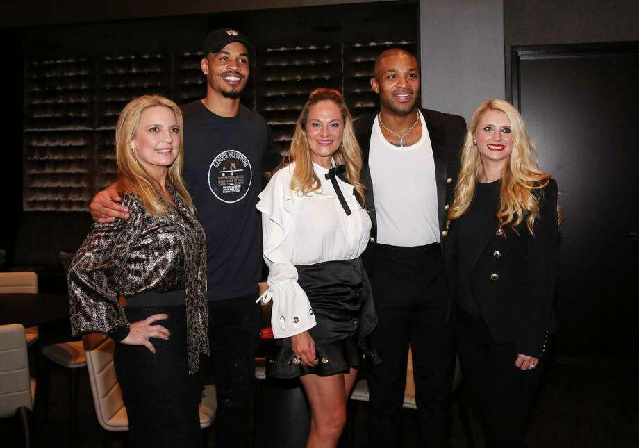 Co-chairs Melissa Juneau, from left, Rachel Regan and Christine Falgout pose for a photograph with Houston Rockets players Gerald Green and P.J. Tucker at the Lexus Lounge before the MVPs courtside dinner, hosted by Houston Rockets and Children's Memorial Hermann, at Toyota Center on Thursday, Oct. 25, 2018, in Houston. Photo: Yi-Chin Lee, Staff Photographer / © 2018 Houston Chronicle
