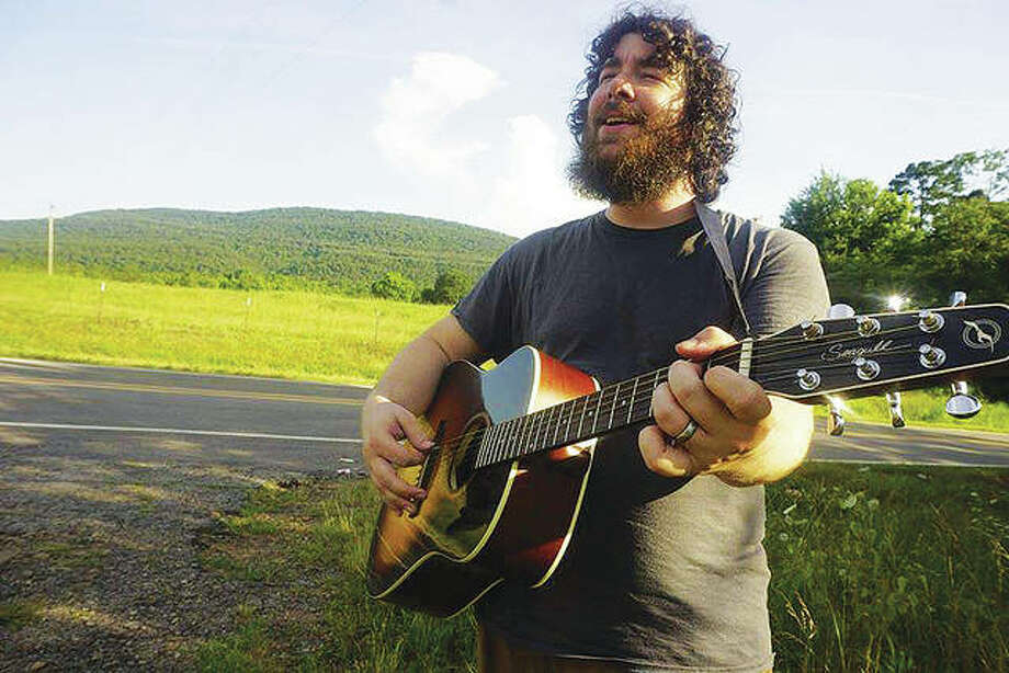 Vocalist and guitarist Jonathan Humphreys, pictured, a music therapist who works with children enrolled in special school district, is playing — for tips only — from 6 to 10 p.m., Saturday, Nov. 10, at The Back Room at Bottle & Barrel, 554 E. Broadway, in Alton, Illinois, for Pennies For PawPaw. Everywhere An Entertainer LLC, founded and owned by Trish Cook, booked Humphreys' gig for the fundraiser. Visit Everywhere An Entertainer LLC at Facebook for more information. Photo: For The Telegraph