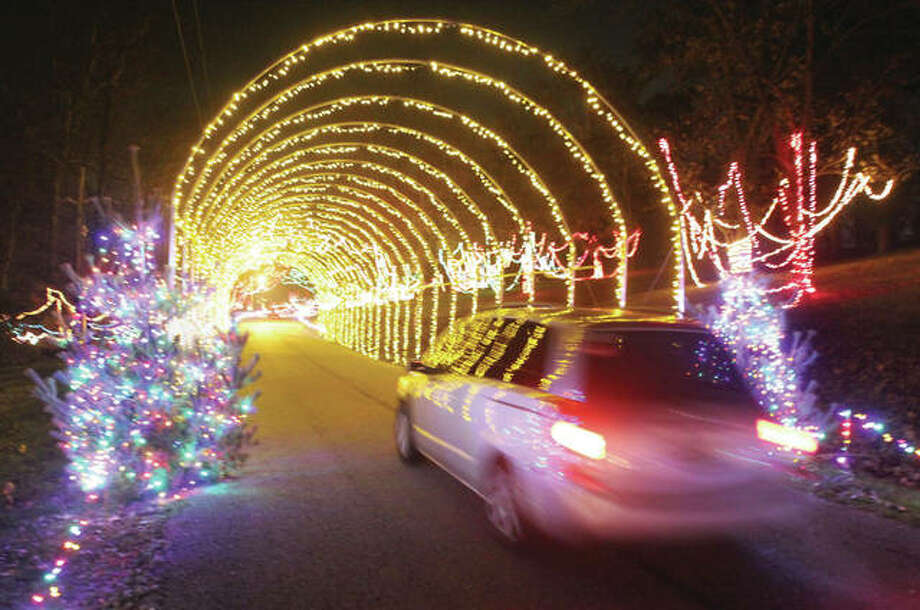 A car heads through one of two light tunnels that are part of the display at Christmas Wonderland in Rock Spring Park. Photo: Scott Cousins | The Telegraph