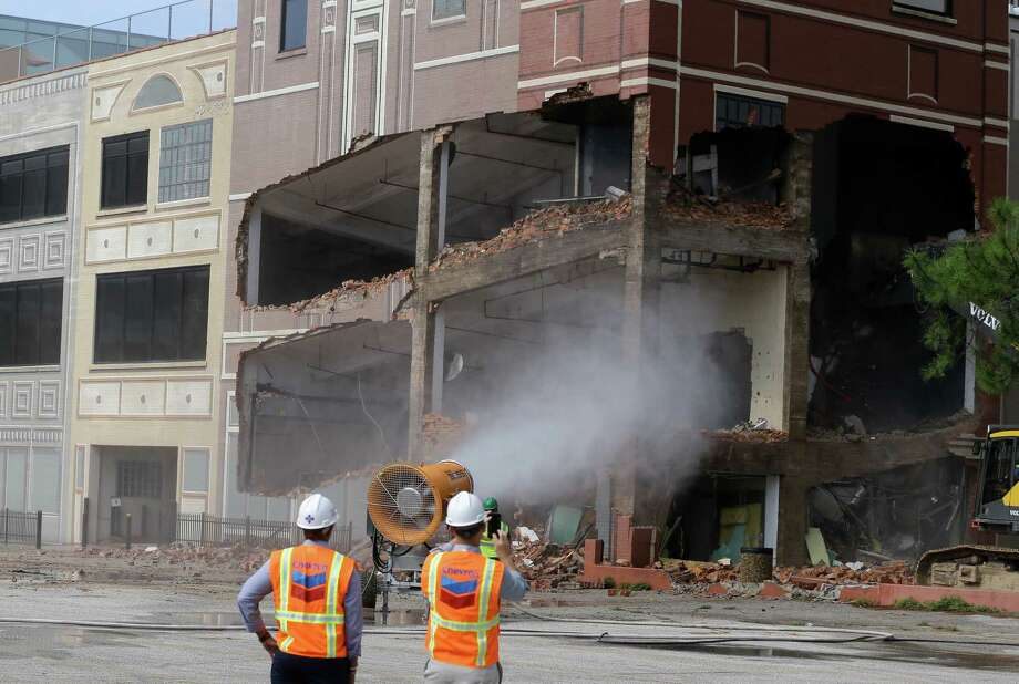 PHOTOS: Downtown Houston building being demolished Demolition of the former Houston Press building at 1621 Milam is shown Tuesday, October 30, 2018. The property is owned by Chevron. >>>See more photos of the ongoing demolition in downtown... Photo: Melissa Phillip, Houston Chronicle / Houston Chronicle
