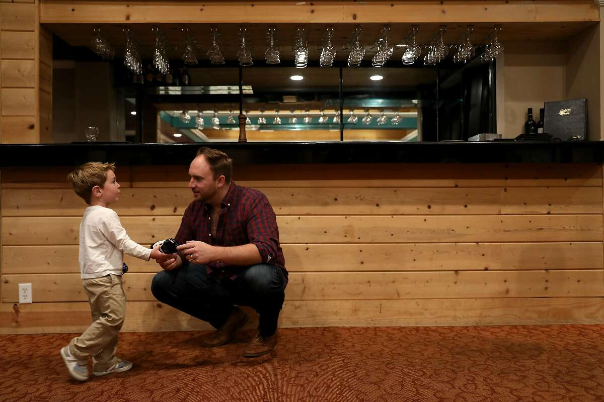 Diner Conor Costello, 2, converses with Connor Patterson, chief strategy and platforms officer, FlipTix, at Gold Mirror in San Francisco, Calif., on Saturday, October 20, 2018. Costello's parents, Michael and Vikki Costello, were there celebrating their 9th wedding anniversary. The Italian restaurant, located at 800 Taraval St., will soon celebrate its 50th anniversary.