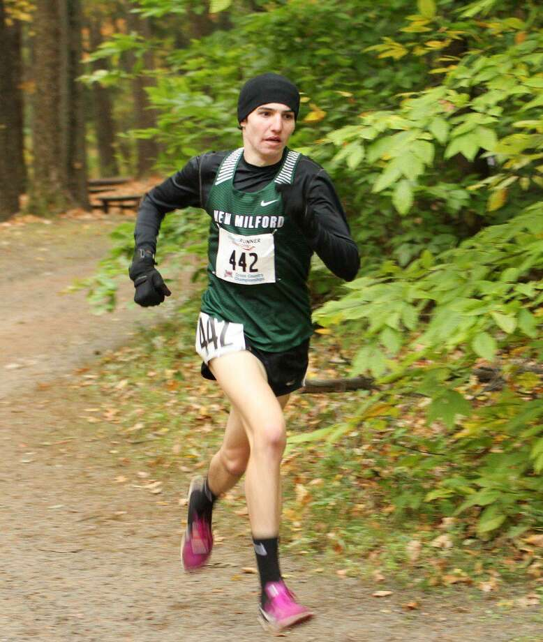 New Milford cross country start, Eli Nahom, ran to his third straight Class L title on Friday, October 26, 2018, at Wickham Park. Photo: Contributed Photo / The News-Times Contributed