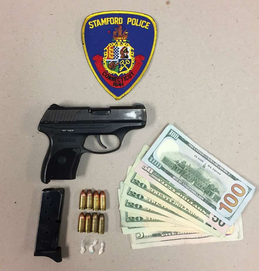 Convicted felon Jonathan Orellano and the pistol police found at his residence on Saturday Oct. 27, 2018 in Stamford. Photo: Stamford Police / Contributed