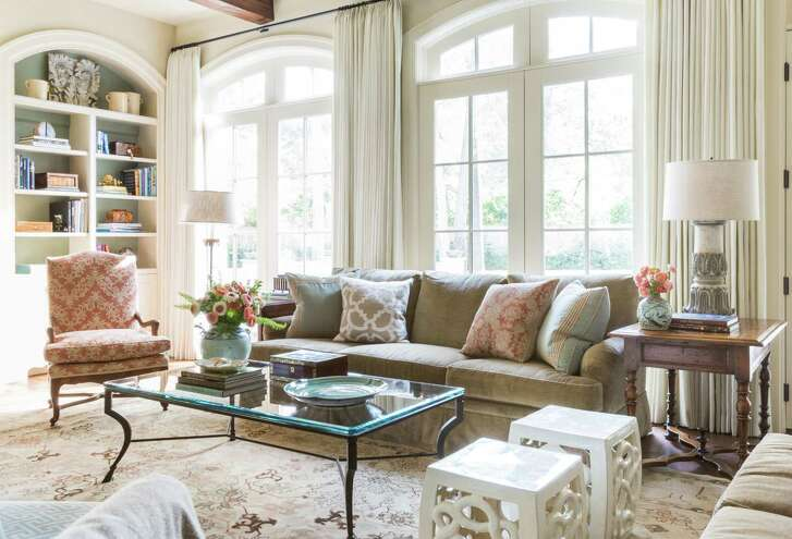 "Martha and Walter ""Buzz"" White's family room uses luxurious furnishings in a comfortable and casual way."