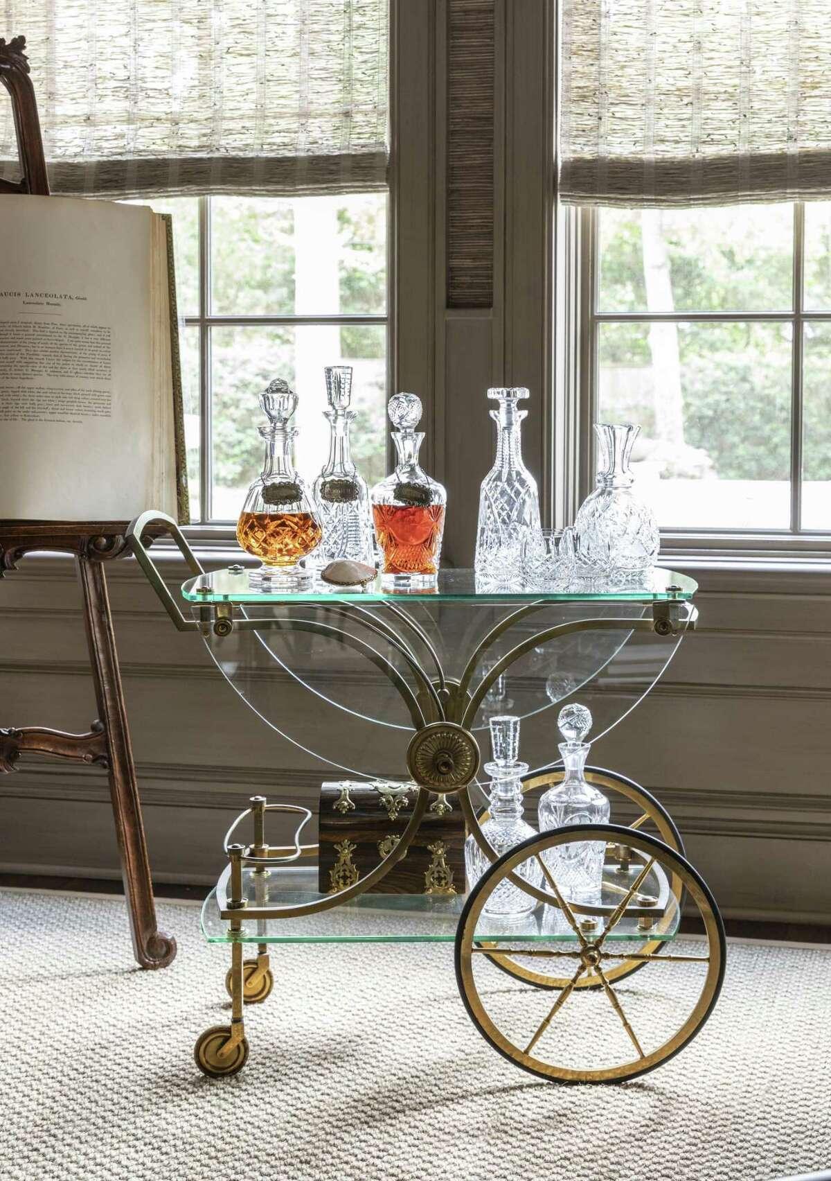 The Whites' interior designer, Sarah Eilers of Lucas/Eilers Design Associates, found this antique brass bar cart at an antiques store in Austin.