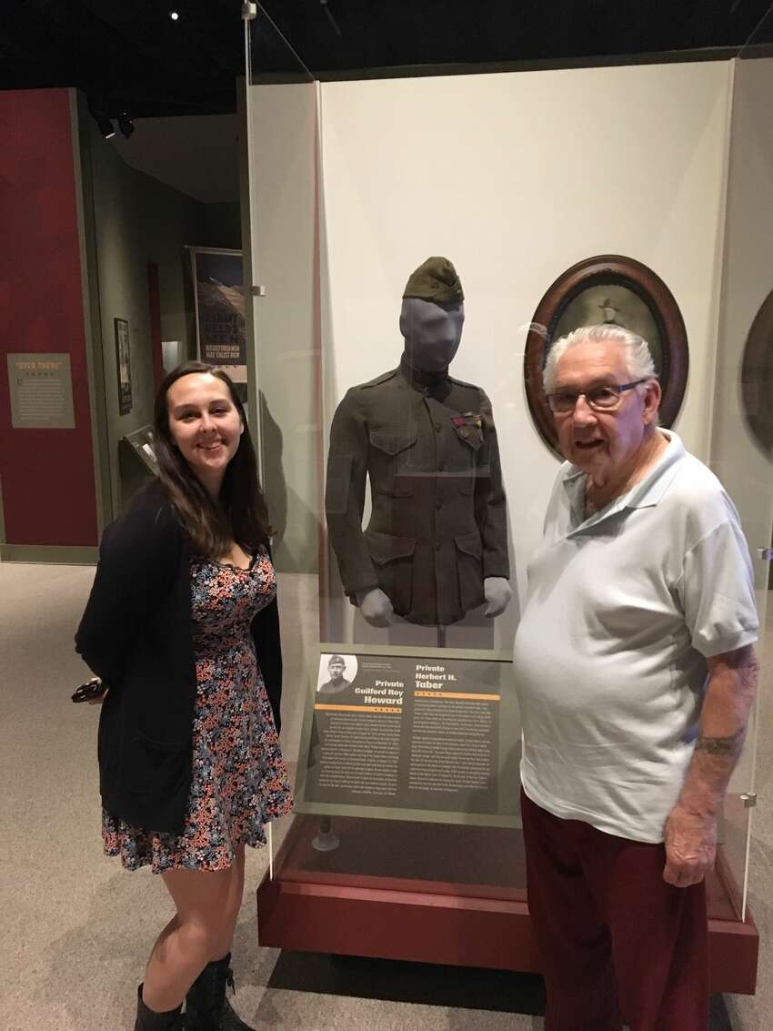 Korean War Marine Corps veteran William G. Howard of Delmar stands with granddaughter Katie Howard of London in front of the World War 1 Marine uniform of Guilford R. Howard of Albany, which the family loaned to the State Museum for its WWI display. Guilford Hoawrd served as a machine gunner in the 5th Marine Battalion. He survived the war and returned to Albany for a long career with A&P Markets.