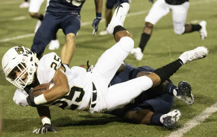 Conroe wide receiver Ameer Patten (25) is brought down by Klein Collins running back Jonathan Lewis (18) during a District 15-6A matchup Thursday at Klein Memorial Stadium. Photo: Cody Bahn, Houston Chronicle / Staff Photographer / © 2018 Houston Chronicle