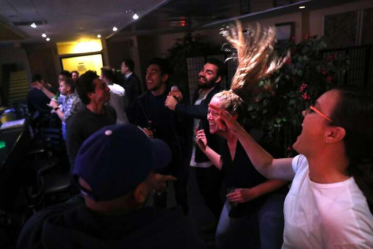 Samantha Ramsey sings a karaoke song with a group of friends at Dimples in San Francisco, Calif.. on Thursday, October 25, 2018.