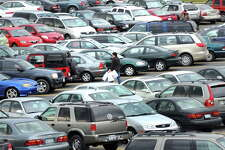 STEVE JACOBS / TIMES UNION , 11/28/08, Colonie,NY-- BLACK FRIDAY -- Vehicles crowd the Crossgates Mall Parking lot as shoppers take advantage of Black Friday sales, Friday, November 28,2008 in Colonie,NY. ( FOR STORY) 1 of 3 photos
