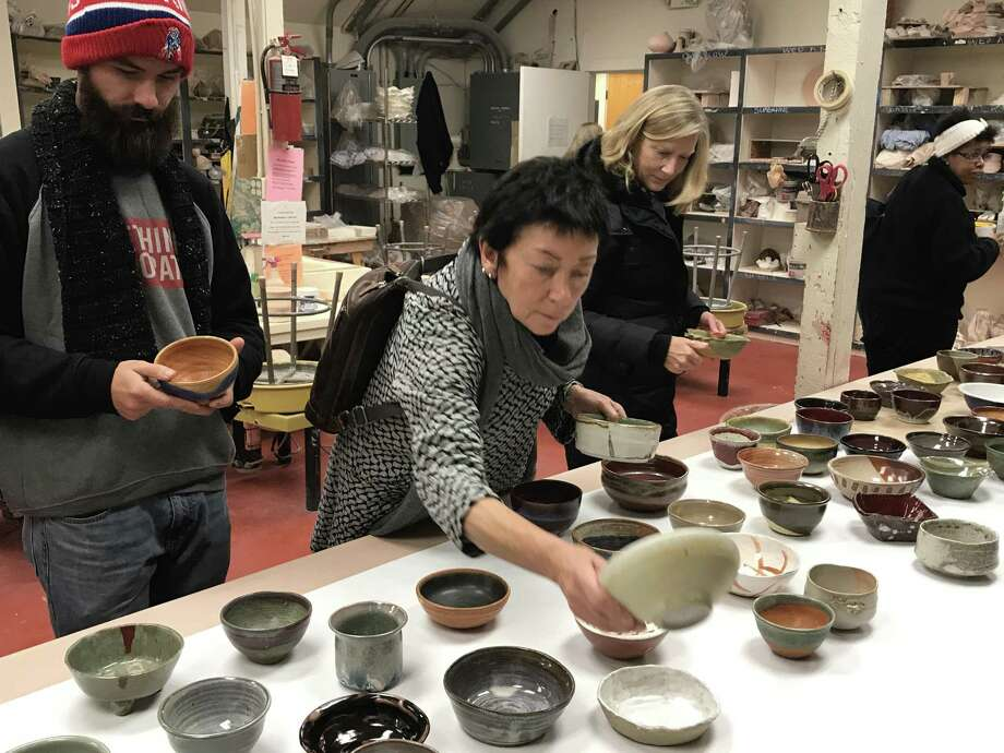 A woman chooses a bowl at last year's event. Photo: Guilford Art Center / Contributed Photo
