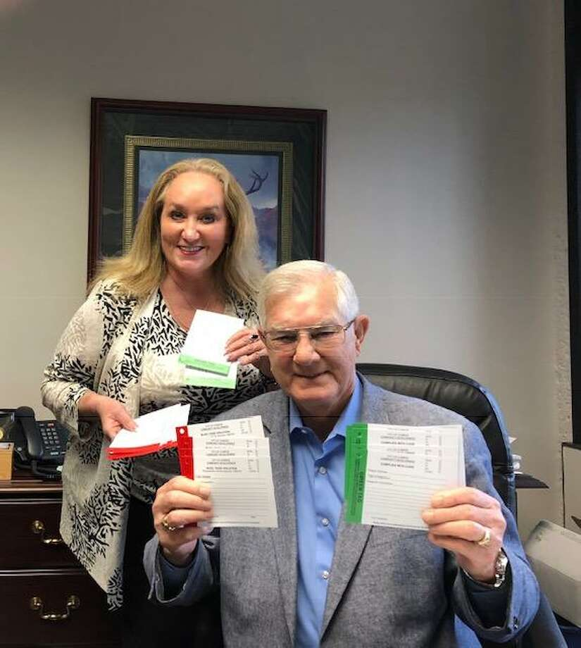 Mayor Toby Powell and Director of Community Development Nancy Mikeska display the new red and green tags the city will used as part of its building inspection process. Photo: Courtesy Photo