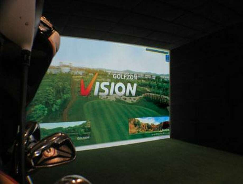 Swing Zone Golf in Tomball has six private bays with GOLFZON Vision simulators. Photo: Swing Zone Golf