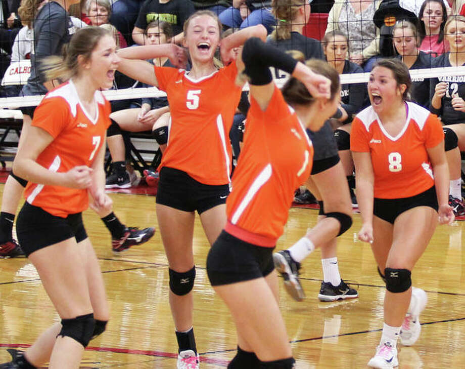 Greenfield's (from left) Kirstin Smay, Hailey Driscoll, Jessa Vetter and Carly Gregory celebrate a set victory over Calhoun in the title match of the Calhoun Class 1A Regional on Thursday in Hardin. Photo: Greg Shashack / The Telegraph