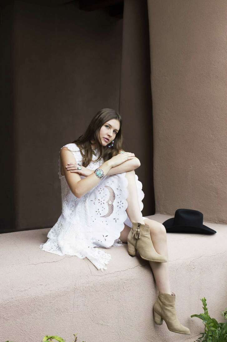 Sofia Resnik-Cornet wears a winter white lace tunic, $995, and short circle skirt, $980, from Martha Medeiros. Suede Zephyr booties, $535, Stuart Weitzman.   Location: Hotel Santa Fe