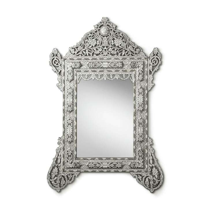 Work of art: Twining leaves, flowers and branches take shape from sinuous lines and lustrous mother-of-pearl inlay of 19th-century Levantine design. RH's hand-carved inlay mirror is a work of art on its own. $4,346; RH Houston, The Gallery at Highland Village or www.rh.com