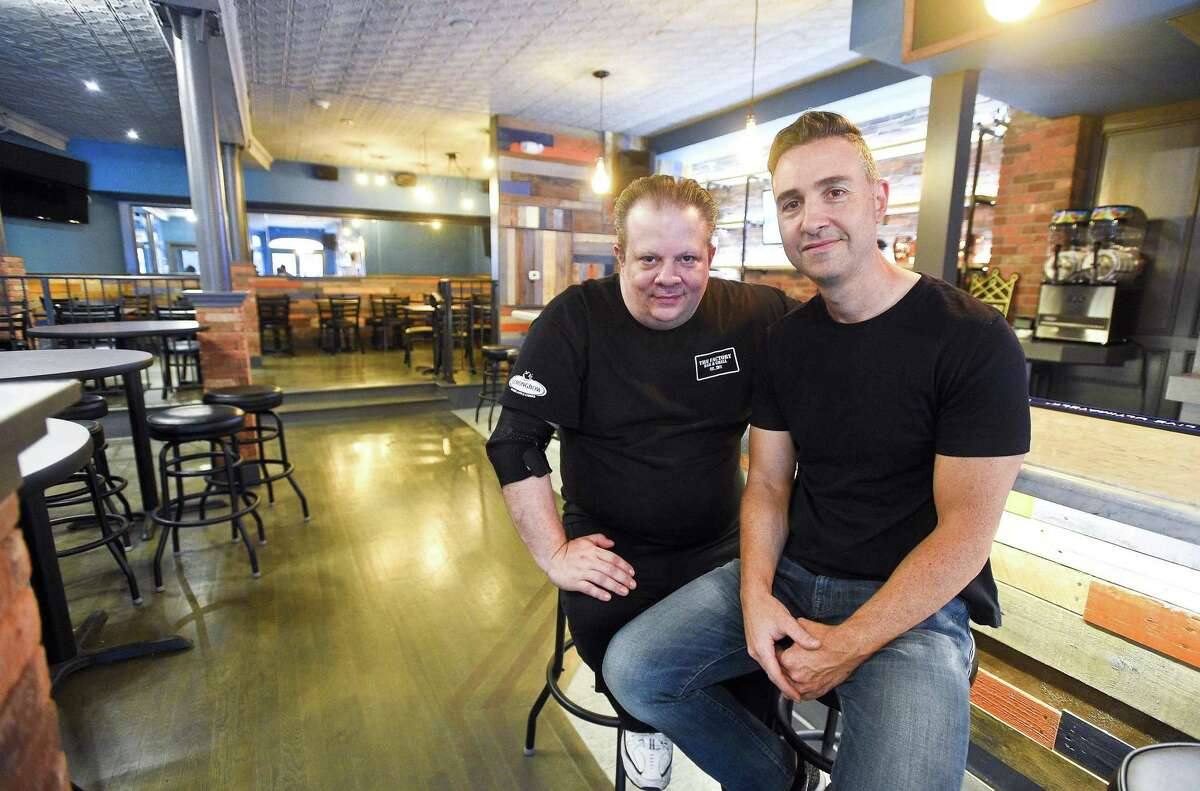 From left, Louie Colantonio and Donny Guarino, two of the three managing partners of Factory Bar & Grill, are photographed in the restaurant, on May 22, 2018, at 261 Main St., in Stamford, Conn.