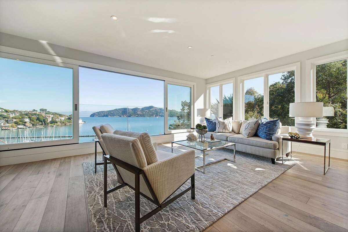 A sliding glass window welcomes breezes off Belvedere Cove into the living room.