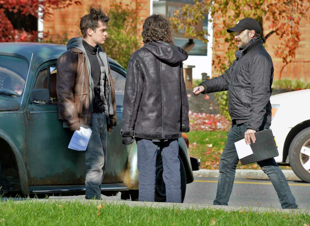"""Actors including Ellar Coltrane, left, and Helena Howard, middle, work with director Stephen Kijak, right, during filming of """"Shoplifters of the World"""" outside Center Station Tuesday Oct. 30, 2018 in Albany, NY. (John Carl D'Annibale/Times Union)"""