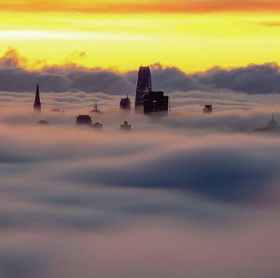 @buza_photography captured this amazing photo of the skyscrapers peaking above the low fog. Photo: Instagram / Buza_photography
