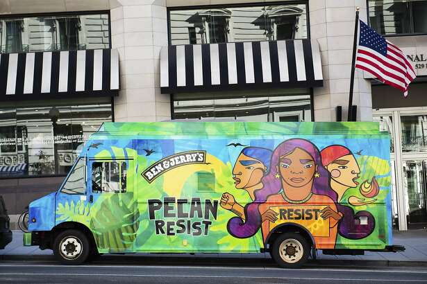 IMAGE DISTRIBUTED FOR BEN & JERRY'S - An ice cream truck spreads the word of Ben & Jerry's new flavor, Pecan Resist, on Tuesday, Oct. 30, 2018, in Washington. (Joy Asico/AP Images for Ben & Jerry's)