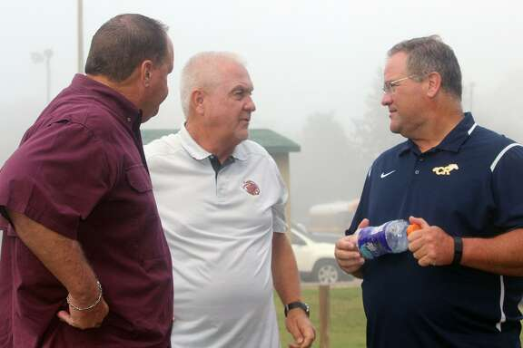Jersey Village High School Head Football Coach David Snokhous (center) talks with two of his fellow head coaches in CFISD Cy-Fair High Schools Ed Pustejovsky (left) and Cypress Ranchs Gene Johnsons at the 2017 District 17-6A cross country meet Oct. 13 at Spring Creek Park in Tomball.