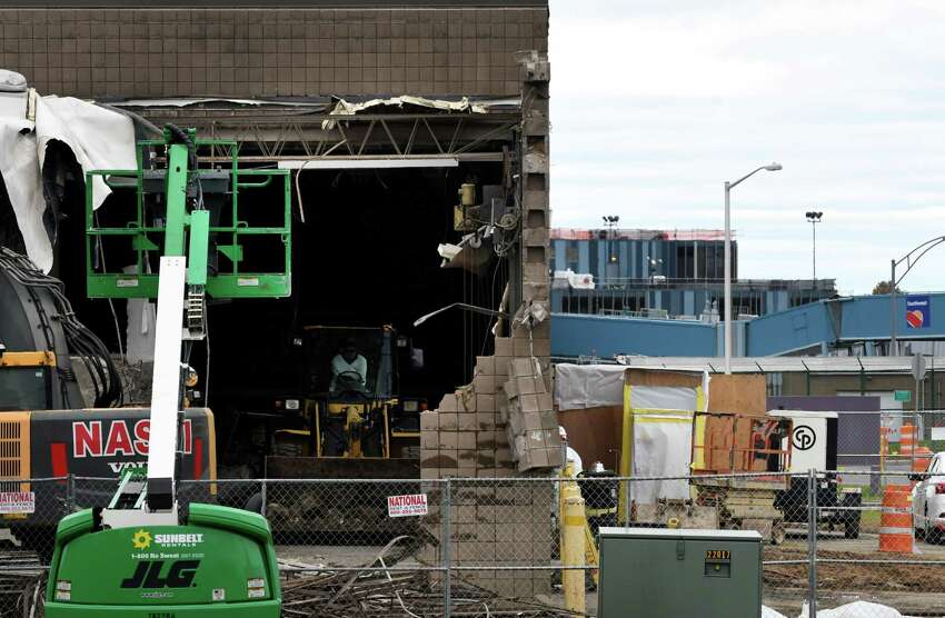 Contractors demolish the former salt storage building on Jetway Drive at Albany International Airport on Tuesday, Oct. 30, 2018, in Colonie, N.Y. The building is being cleared to make way for a new parking garage at the airport. (Will Waldron/Times Union)