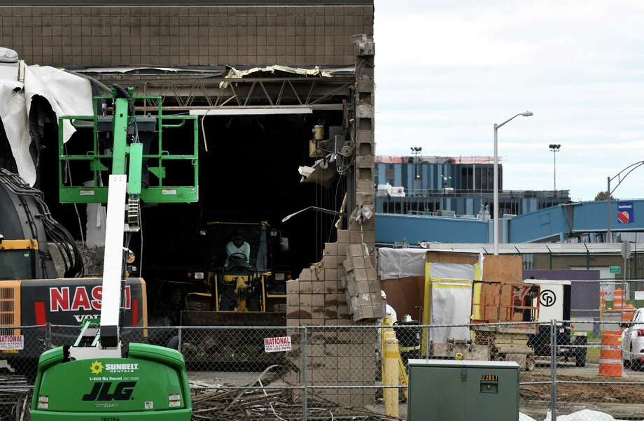 Contractors demolish the former salt storage building on Jetway Drive at Albany International Airport on Tuesday, Oct. 30, 2018, in Colonie, N.Y. The building is being cleared to make way for a new parking garage at the airport. (Will Waldron/Times Union) Photo: Will Waldron, Albany Times Union / 40045333A