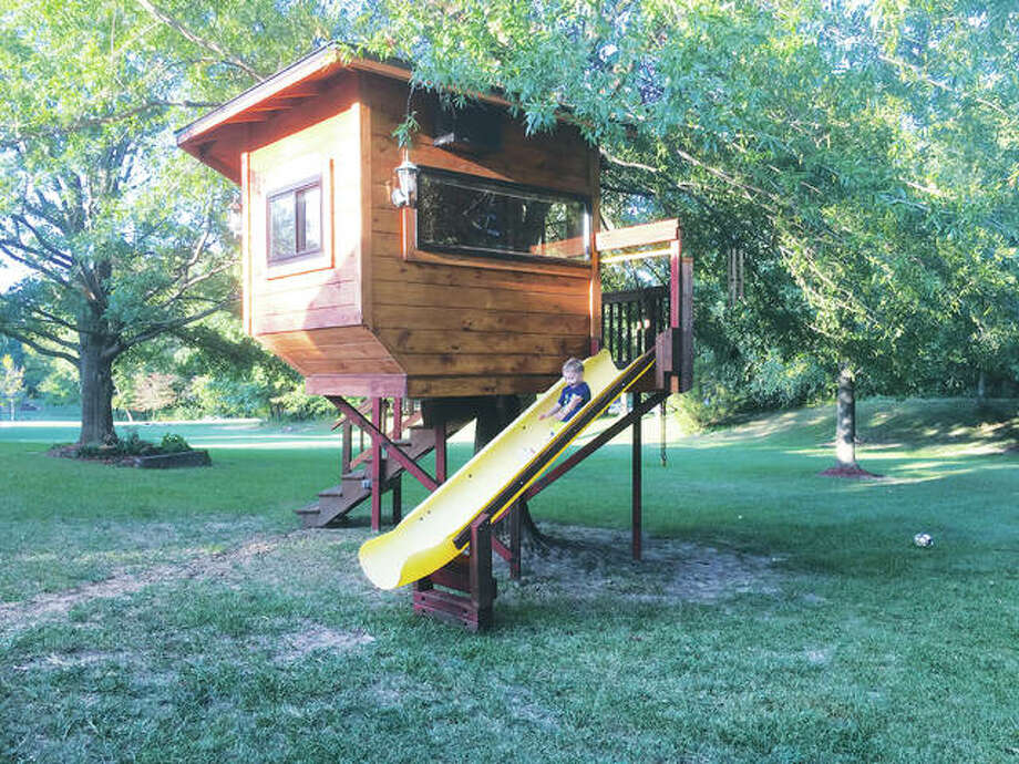 """Treehouses are for building memories with friends and family,"" said Jennale Liston, of Collinsville, Illinois, before a toast with her husband, Steve Liston. ""It goes with wine with the girls and Steve with his beer. We got the idea when we got together. We picked the tree. We like 'Tiny Houses' and 'Treehouse Masters' and wanted to create something special for our boys, friends and family."" Photo: Jill Moon