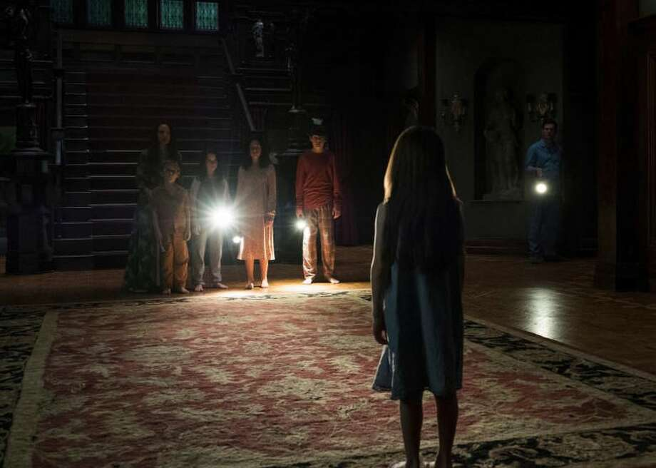 """""""The Haunting of Hill House"""" TV series on Netflix is a reimagining of the beloved Shirley Jackson novel of the same name about five siblings who grew up in the famous haunted house with their parents. Photo: CBSI/CNET"""