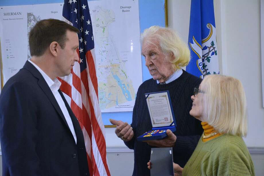 At a ceremony at the Sherman Town Hall, on Oct. 25, Sen. Chris Murphy, D-Conn., presented a congressional certificate and the Korean Ambassador for Peace Medal to Thomas Alexander White. Photo: Contributed Photo / The News-Times Contributed